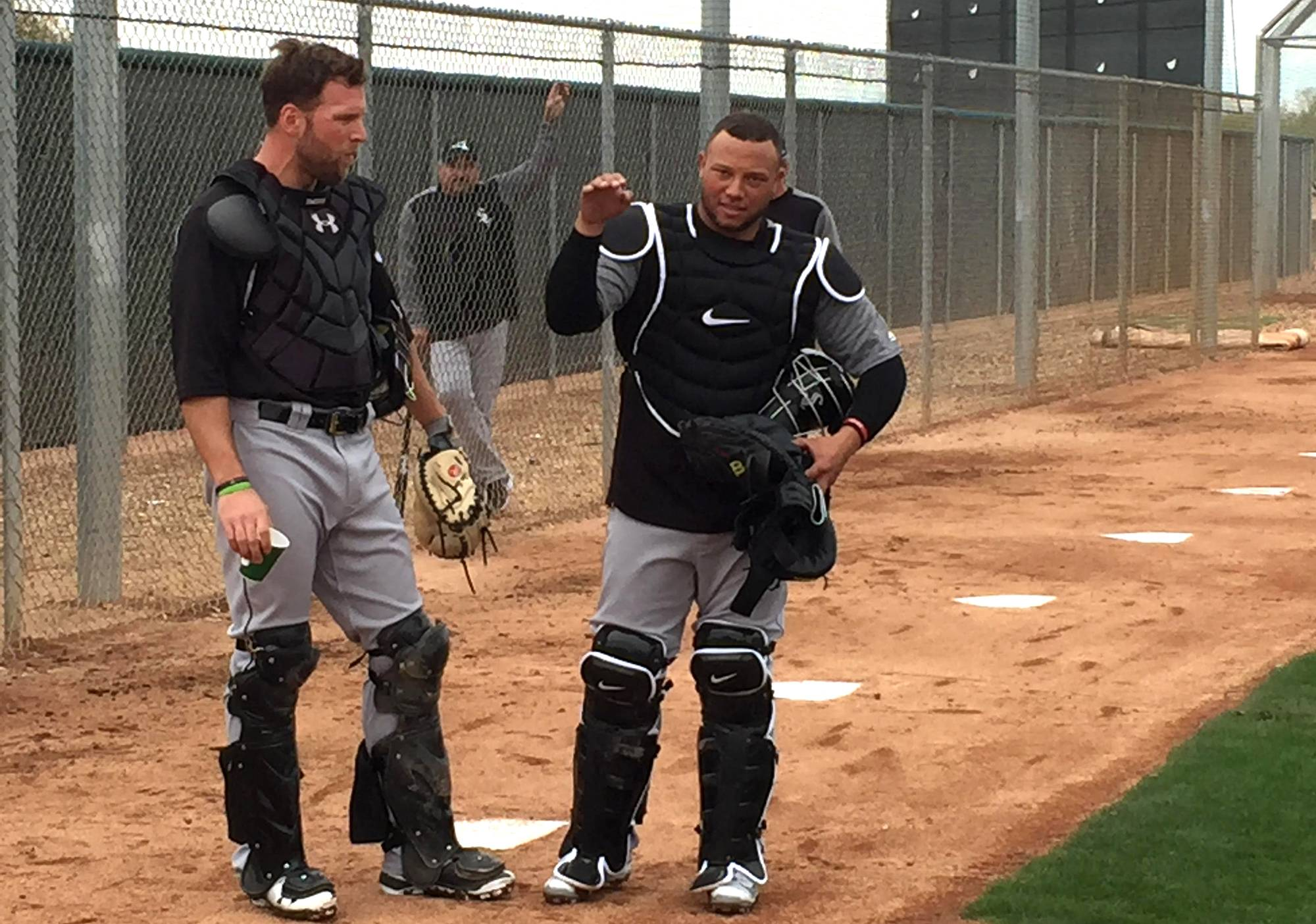 New White Sox catcher Welington Castillo, right, makes a point as the Sox work out at spring training at Glendale, Arizona, and Camelback Ranch on Friday, Feb. 16, 2018.