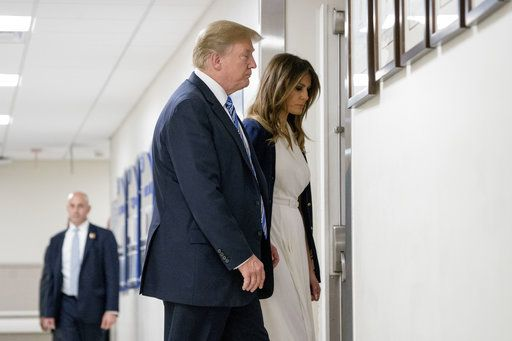 President Donald Trump and first lady Melania Trump, right, depart after visiting with medical staff at Broward Health North in Pompano Beach, Fla., Friday, Feb. 16, 2018, following Wednesday's shooting at Marjory Stoneman Douglas High School, in Parkland, Fla.