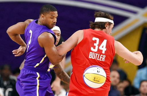 Actor Michael B. Jordan, left, of Team Lakers, knocks the ball away from Arcade Fire singer Win Butler, of Team Clippers, during the NBA All-Star Celebrity Game on Friday, Feb. 16, 2018, in Los Angeles.
