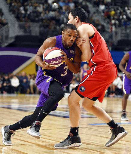 Actor Michael B. Jordan, left, of Team Lakers, drives past Canadian personality Jonathan Scott, of Team Clippers, during the NBA All-Star celebrity basketball game Friday, Feb. 16, 2018, in Los Angeles.