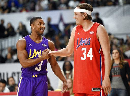 Actor Michael B. Jordan, left, and Arcade Fire singer Win Butler shake hands during the NBA All-Star celebrity basketball game Friday, Feb. 16, 2018, in Los Angeles.