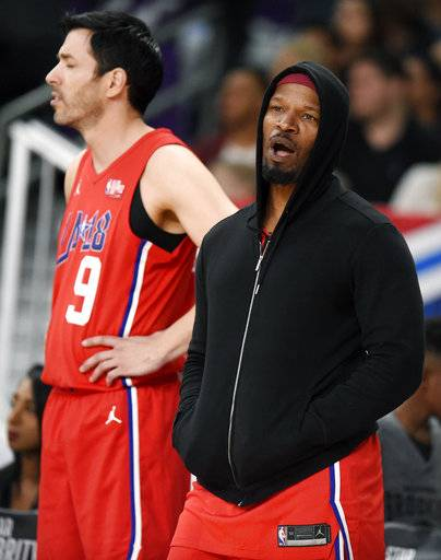 Actor Jamie Foxx, right, and Canadian TV personality Jonathan Scott, of Team Clippers, react to a referee's call during the NBA All-Star celebrity basketball game Friday, Feb. 16, 2018, in Los Angeles.
