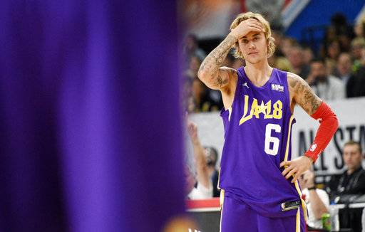 Musician Justin Bieber, of Team Lakers, reacts to a play during the NBA All-Star celebrity basketball game Friday, Feb. 16, 2018, in Los Angeles.