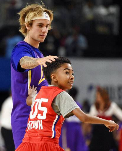 Musician Justin Bieber, of Team Lakers, top, has some fun with actor Miles Brown, of Team Clippers, during the NBA All-Star celebrity basketball game on Friday, Feb. 16, 2018, in Los Angeles.