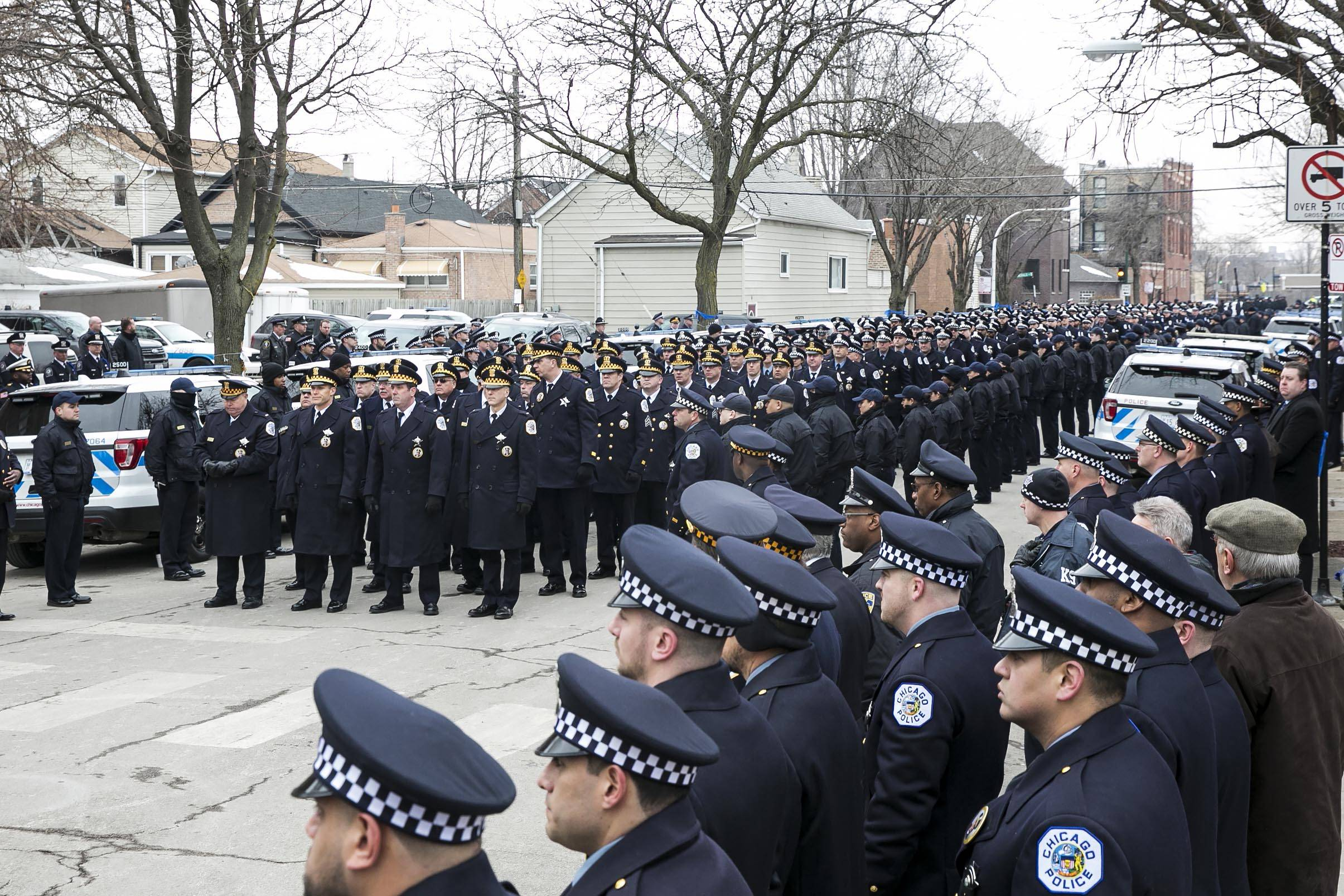 Hundreds of officers attend the funeral for Chicago Police Cmdr. Paul Bauer at Nativity of Our Lord Catholic Church, Saturday, Feb. 17, 2018. Bauer was shot to death Tuesday outside the Thompson Center, where he had confronted a man who was fleeing other officers.