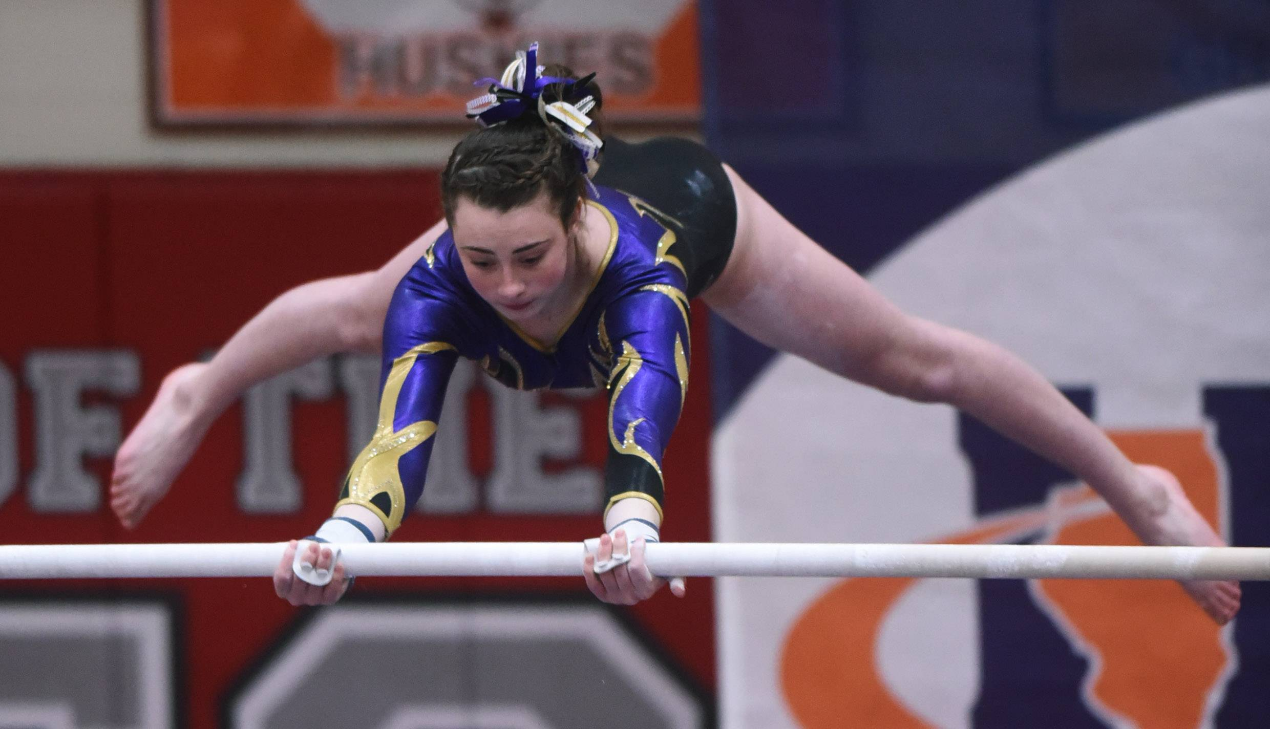 Rolling Meadows' Nicole Kane competes on the uneven parallel bars during the girls state gymnastics meet at Palatine High School Saturday.