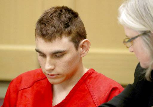 Nikolas Cruz appears in court for a status hearing before Broward Circuit Judge Elizabeth Scherer in Fort Lauderdale, Fla., Monday, Feb. 19, 2018. Cruz is charged with killing 17 people and wounding many others in Wednesday's attack at Marjory Stoneman Douglas High School  in Parkland, which he once attended. (Mike Stocker/South Florida Sun-Sentinel via AP, Pool)