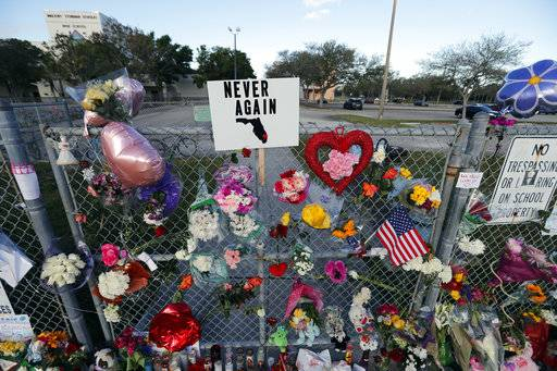 A makeshift memorial is seen outside the Marjory Stoneman Douglas High School, where 17 students and faculty were killed in a mass shooting on Wednesday, in Parkland, Fla., Monday, Feb. 19, 2018. Nikolas Cruz, a former student, was charged with 17 counts of premeditated murder on Thursday.