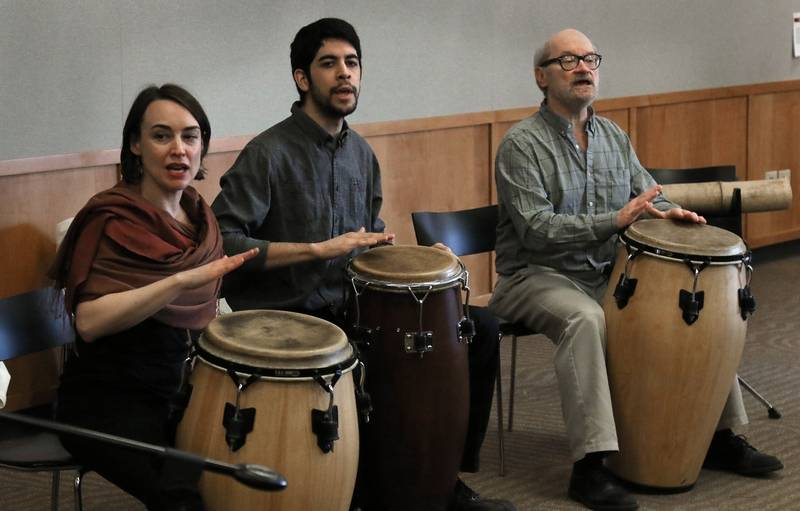 Anna Pansard, left, Jose Vega and Don Skoog play congas Sunday during a performance of the Contemporary Music Project Percussion Ensemble at the Ela Area Public Library in Lake Zurich.