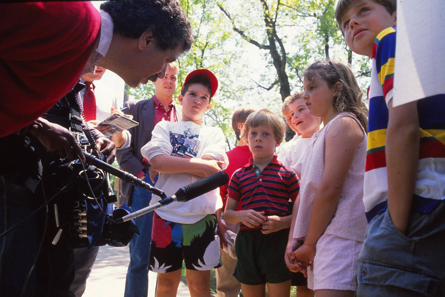 Reporters interviewed children in 1988 outside the Hubbard Woods Elementary School in Winnetka after a boy was killed and five other students critically hurt by an intruder with guns.