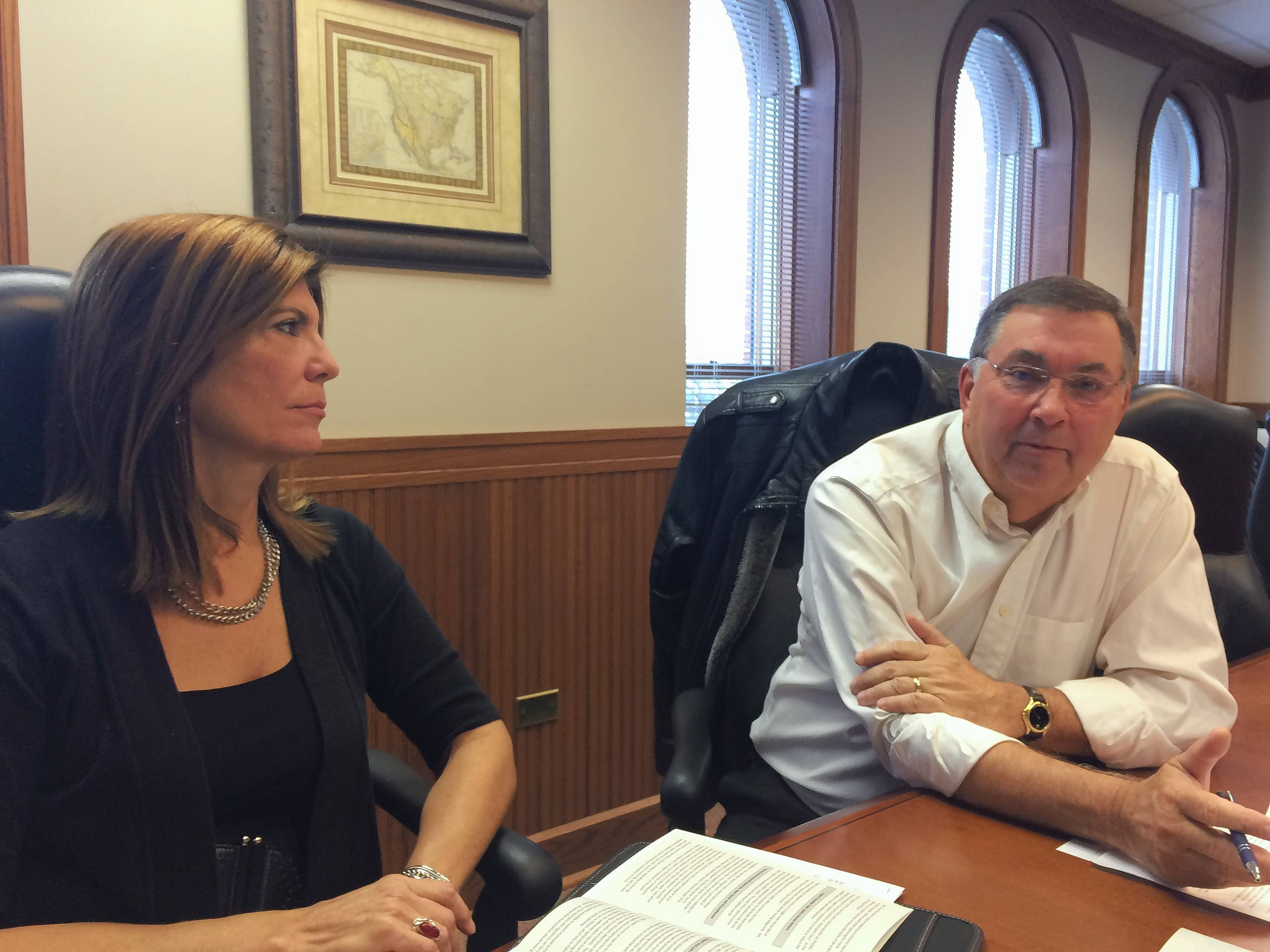 Janet Agnoletti, left, executive director of the Barrington Area Council of Governments, listens Monday as the organization's board chairman, Tower Lakes Village President David Parro, discusses legislative priorities in Springfield this year.