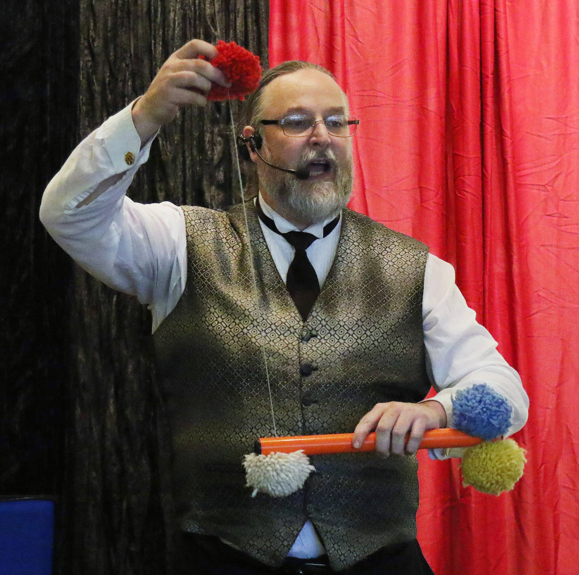 Magician Keith Cobb performs a trick Monday at Wauconda Area Library.