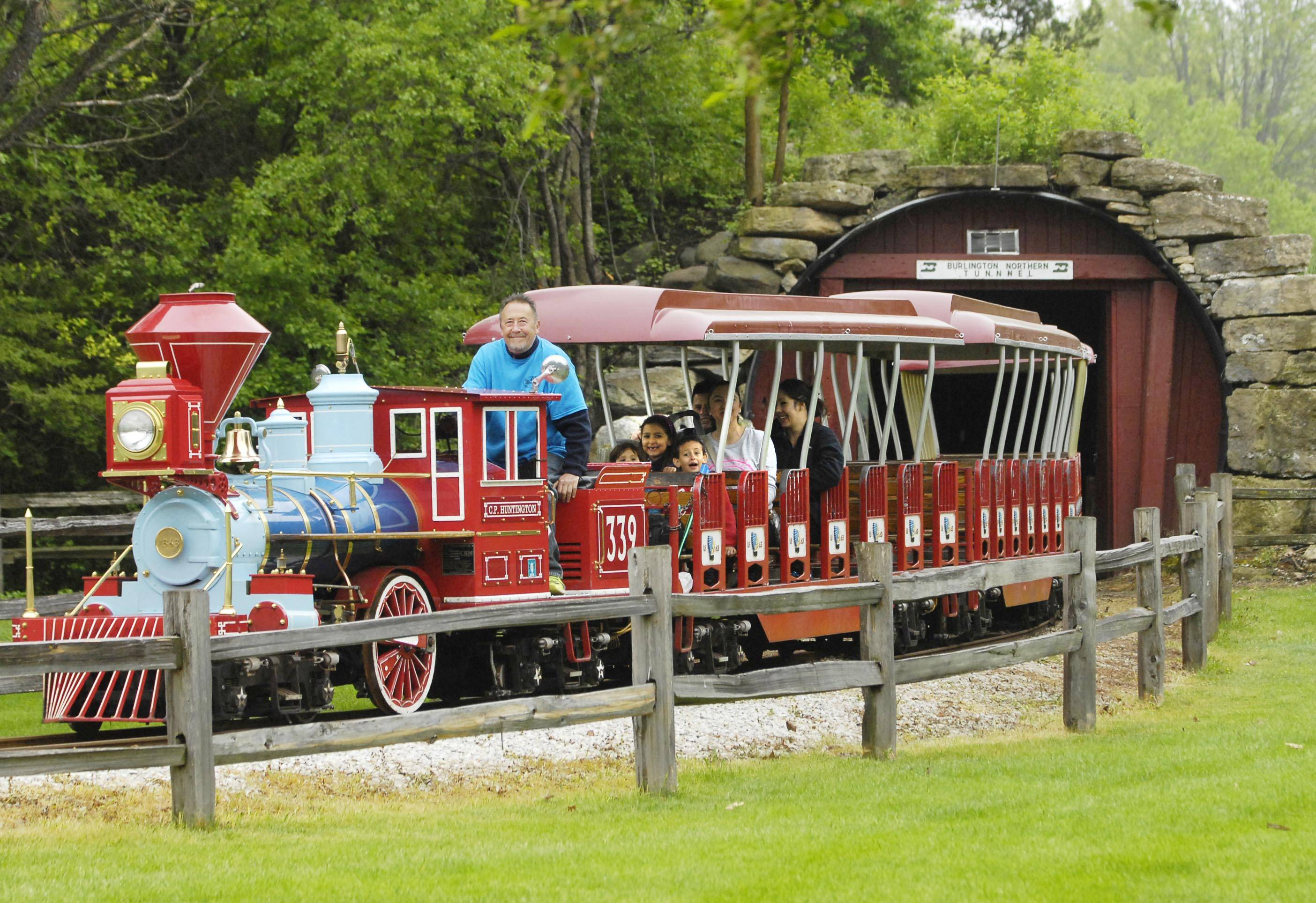 Families take a train ride at Blackberry Farm on Barnes Road in Aurora. The farm, part of the Fox Valley Park District, is a living history museum with plenty of activities for families.