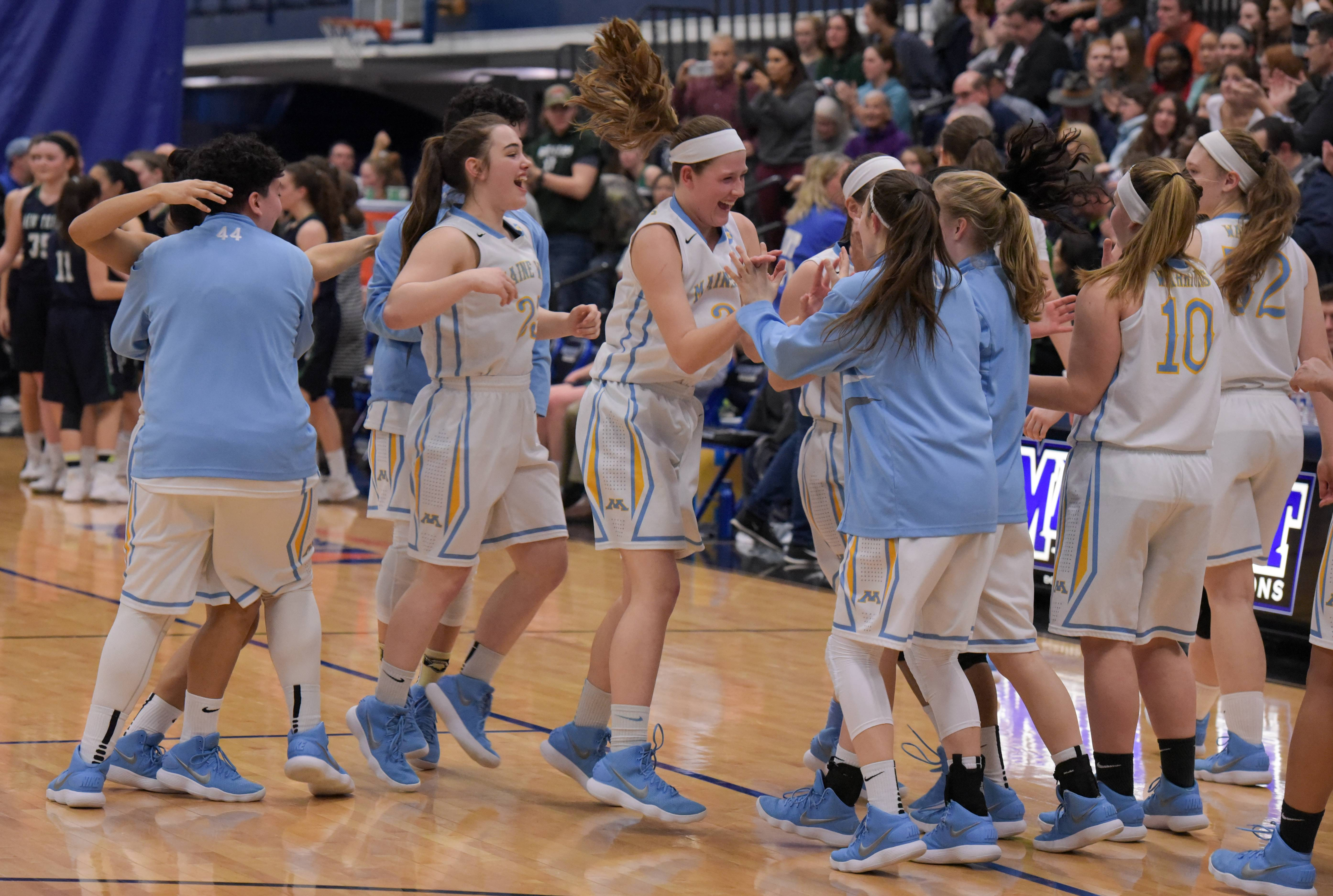 Maine West's girls basketball team celebrates its 52-38 win over New Trier during the Maine East sectional semifinal on Monday.