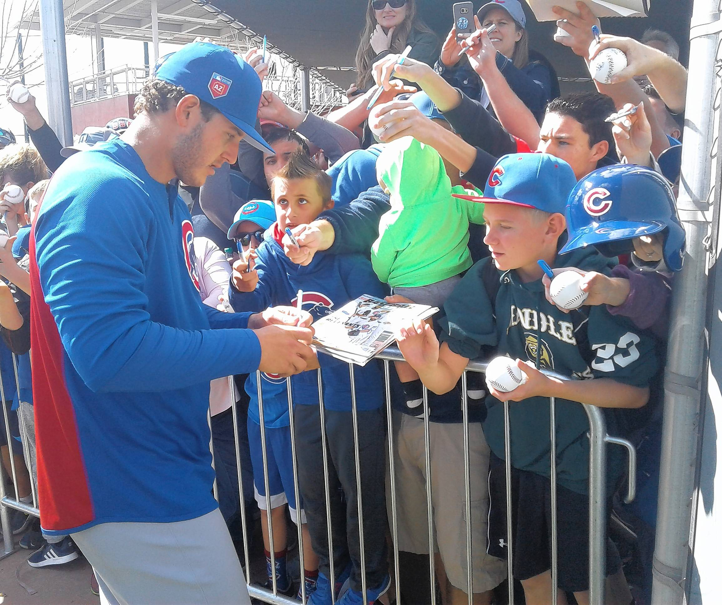 Chicago Cubs first baseman Anthony Rizzo interacts with fans Monday as the Cubs held their first full spring training workout in Mesa, Arizona.