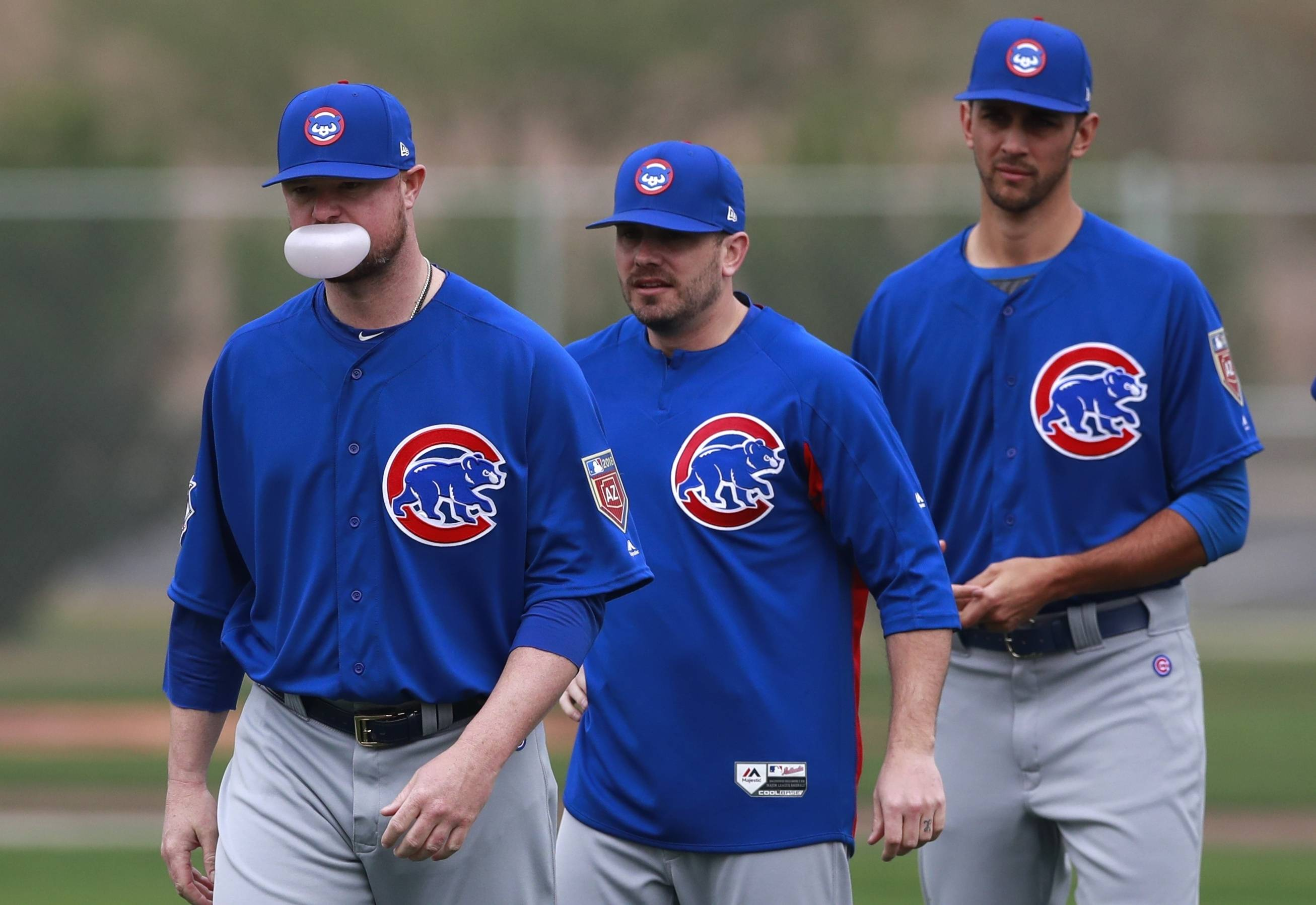 Chicago Cubs starting pitcher Jon Lester leads teammates in a stretching drill at the team's spring training baseball facility Friday, Feb. 16, 2018, in Mesa, Ariz. (AP Photo/Carlos Osorio)