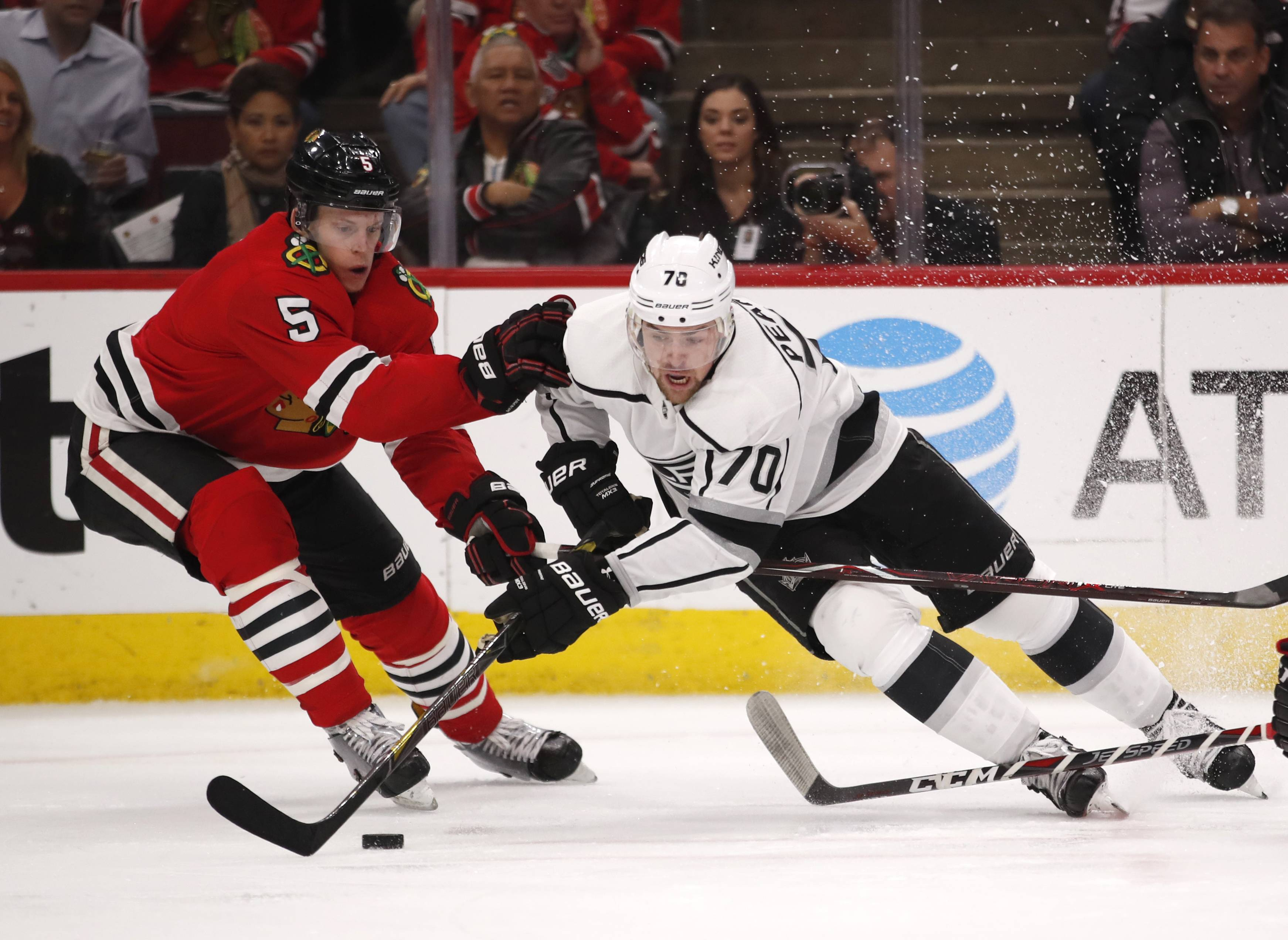 Los Angeles Kings left wing Tanner Pearson (70) tries to get past Chicago Blackhawks defenseman Connor Murphy (5) with the puck during the second period of an NHL hockey game Monday, Feb. 19, 2018, in Chicago. (AP Photo/Jeff Haynes)