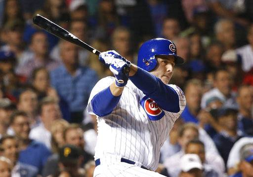 FILE - In this Aug. 29, 2017, file photo, Chicago Cubs' Anthony Rizzo doubles off Pittsburgh Pirates starting pitcher Chad Kuhl during the sixth inning of a baseball game, in Chicago. Rizzo arrived for its first full-squad workout after returning to Florida to support victims of last week's deadly shooting at his former high school. (AP Photo/Charles Rex Arbogast, File)