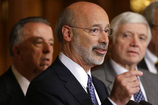 FILE - In this Oct. 7, 2015, file photo, Pennsylvania Gov. Tom Wolf, center, accompanied by state House Minority Leader Rep. Frank Dermody, right, D-Allegheny, and state Rep. Joe Markosek, left, D-Allegheny, discuss state budget negotiations at the state Capitol in Harrisburg, Pa. Pennsylvania's high court issued a new congressional district map for the state's 2018 elections on its self-imposed deadline Monday, Feb. 19, 2018, all but ensuring that Democratic prospects will improve in several seats and that Republican lawmakers challenge it in federal court. The map of Pennsylvania's 18 congressional districts is to be in effect for the May 15 primary and substantially overhauls a congressional map widely viewed as among the nation's most gerrymandered. The map was approved in a 4-3 decision. (AP Photo/Matt Rourke, File)