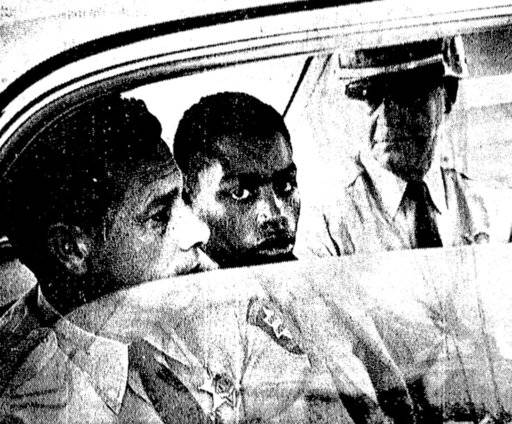 RETRANSMITTED TO UPDATE CAPTION AFTER PAROLE BOARD DECISION - FILE - In this February 1964 file photo, Henry Montgomery, flanked by two deputies, awaits the verdict in his trial for the murder of Deputy Sheriff Charles H. Hurt in Louisiana.  On  Monday, Feb. 19, 2018, a three-member panel must decide whether to grant parole to Montgomery, a prisoner who's getting his first chance at freedom after nearly a half-century behind bars. (John Boss/The Advocate via AP, File)/The Advocate via AP)