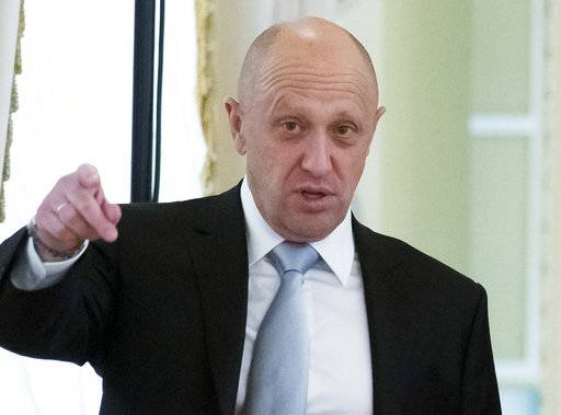 "FILE - In this Tuesday, Aug. 9, 2016 file photo, businessman Yevgeny Prigozhin gestures at the Konstantin palace outside St. Petersburg, Russia. One of those indicted in the Russia probe is a businessman with ties to Russian President Vladimir Putin. Prigozhin is an entrepreneur from St. Petersburg who's been dubbed ""Putin's chef"" by Russian media. His restaurants and catering businesses have hosted the Kremlin leader's dinners with foreign dignitaries."