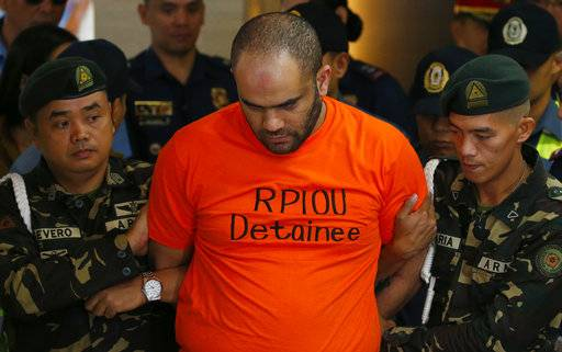 Philippine National Police Chief Gen. Ronald Dela Rosa presents to the media arrested foreigner Fehmi Lassoued, also known as John Rasheed Lassoned, allegedly a native of Egypt, along with a Filipino companion Anabel Moncera Salipada Monday, Feb. 19, 2018 at Camp Crame in suburban Quezon city northeast of Manila, Philippines. Lassoued and Salipada were arrested over the weekend in possession of assorted firearms, ammunitions and components for IED (Improvised Explosives Device) such as electronic resistors, capacitors, batteries and pipe fittings. (AP Photo/Bullit Marquez)