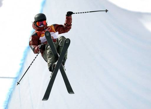Cassie Sharpe, of Canada, jumps during the women's halfpipe qualifying at Phoenix Snow Park at the 2018 Winter Olympics in Pyeongchang, South Korea, Monday, Feb. 19, 2018. (AP Photo/Kin Cheung)