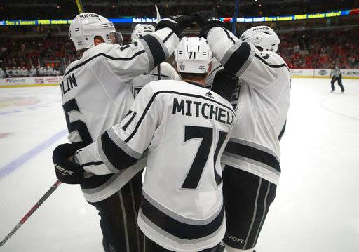 Los Angeles Kings center Torrey Mitchell (71) celebrates with teammate after scoring a goal against the Chicago Blackhawks during the first period of an NHL hockey game Monday, Feb. 19, 2018, in Chicago. (AP Photo/Jeff Haynes)