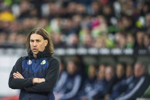 FILE - In this Feb. 17, 2018 file photo VfL Wolfsburg coach Trainer Martin Schmidt attends the soccer match between VfL Wolfsburg and Bayern Munich in Wolfsburg, northern Germany. Schmidt resigned as coach, the club announced on their homepage Monday, Feb. 19, 2018. (Swen Pfoertner/dpa via AP,file)