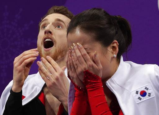 Yura Min and Alexander Gamelin of South Korea react as their points are posted following their performance in the ice dance, short dance figure skating in the Gangneung Ice Arena at the 2018 Winter Olympics in Gangneung, South Korea, Monday, Feb. 19, 2018. (AP Photo/Julie Jacobson)