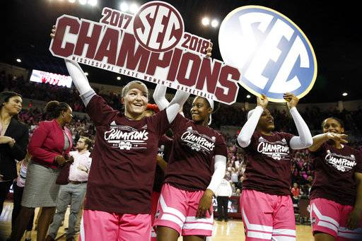 Mississippi State players celebrate their capturing the SEC regular-season title following their 76-55 win over Texas A&M in their NCAA college basketball game in Starkville, Miss., Sunday Feb. 18, 2018. (Associated Press/Rogelio V. Solis/)