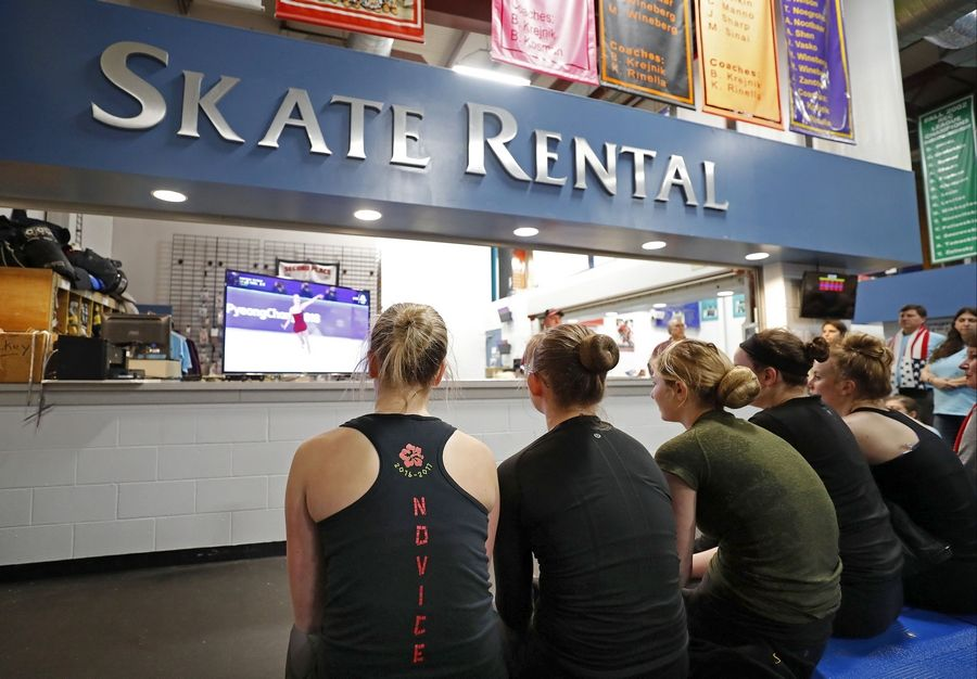 Skaters take a break Tuesday to watch Olympic figure skater Bradie Tennell skate her short program at the Pyeongchang Olympics during a viewing party at Twin Rinks Ice Pavilion in Buffalo Grove.