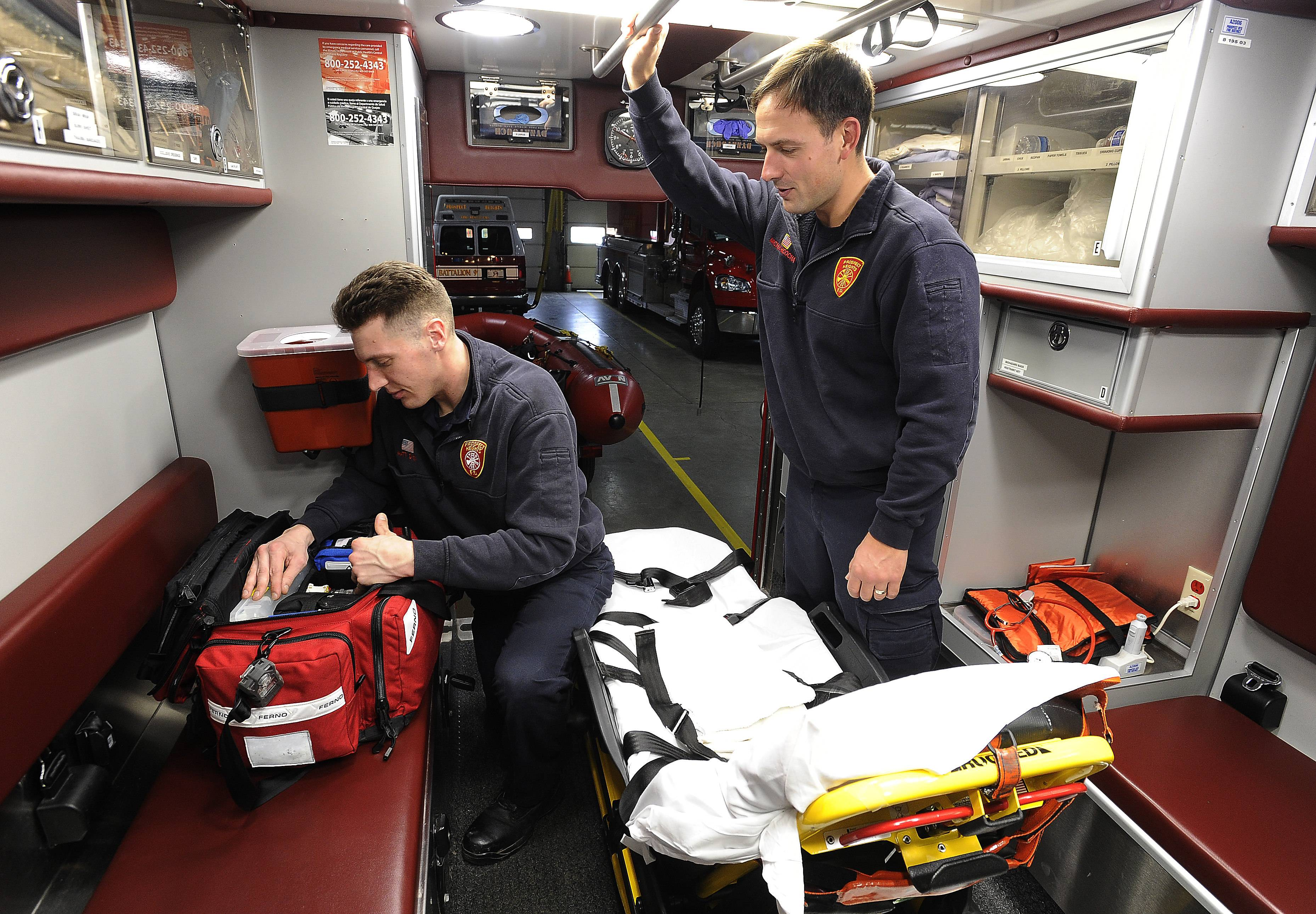 Prospect Heights firefighter/paramedic Mike Pacocha, right, works with partner Matt Dyer checking their supplies after responding to a call. Voters will decide March 20 whether to approve a tax hike to prevent staff and service cuts at the Prospect Heights Fire Protection District.