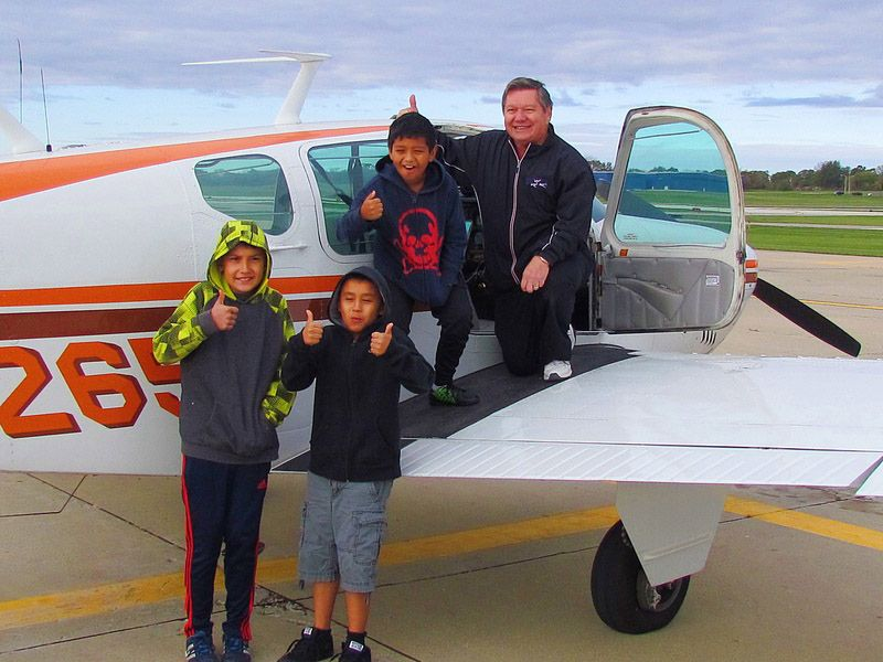 Libertyville pilot volunteers to take kids to new heights