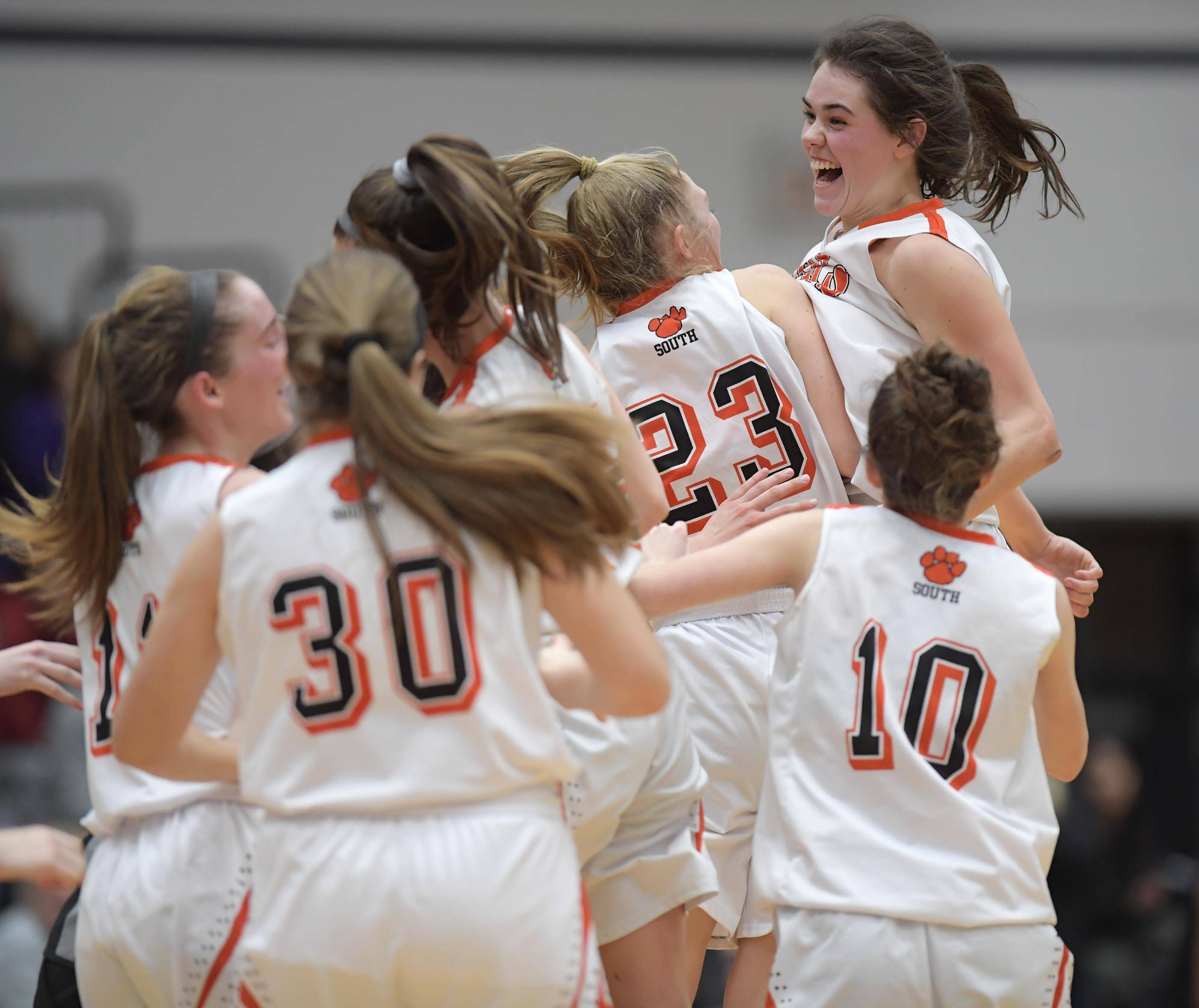 Wheaton Warrenville South's MacKenzie Stebbins celebrates the Tigers' win against Rolling Meadows Tuesday in the Lake Park girls basketball sectional semifinal game.