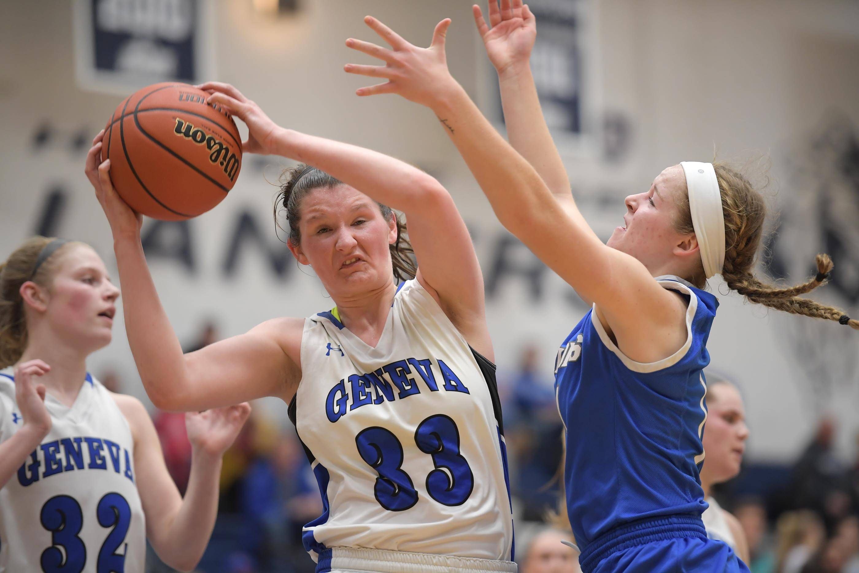 Geneva's Madison Mallory gets a rebound agains Wheaton North's Matti Zander Tuesday in the Lake Park girls basketball sectional semifinal game.