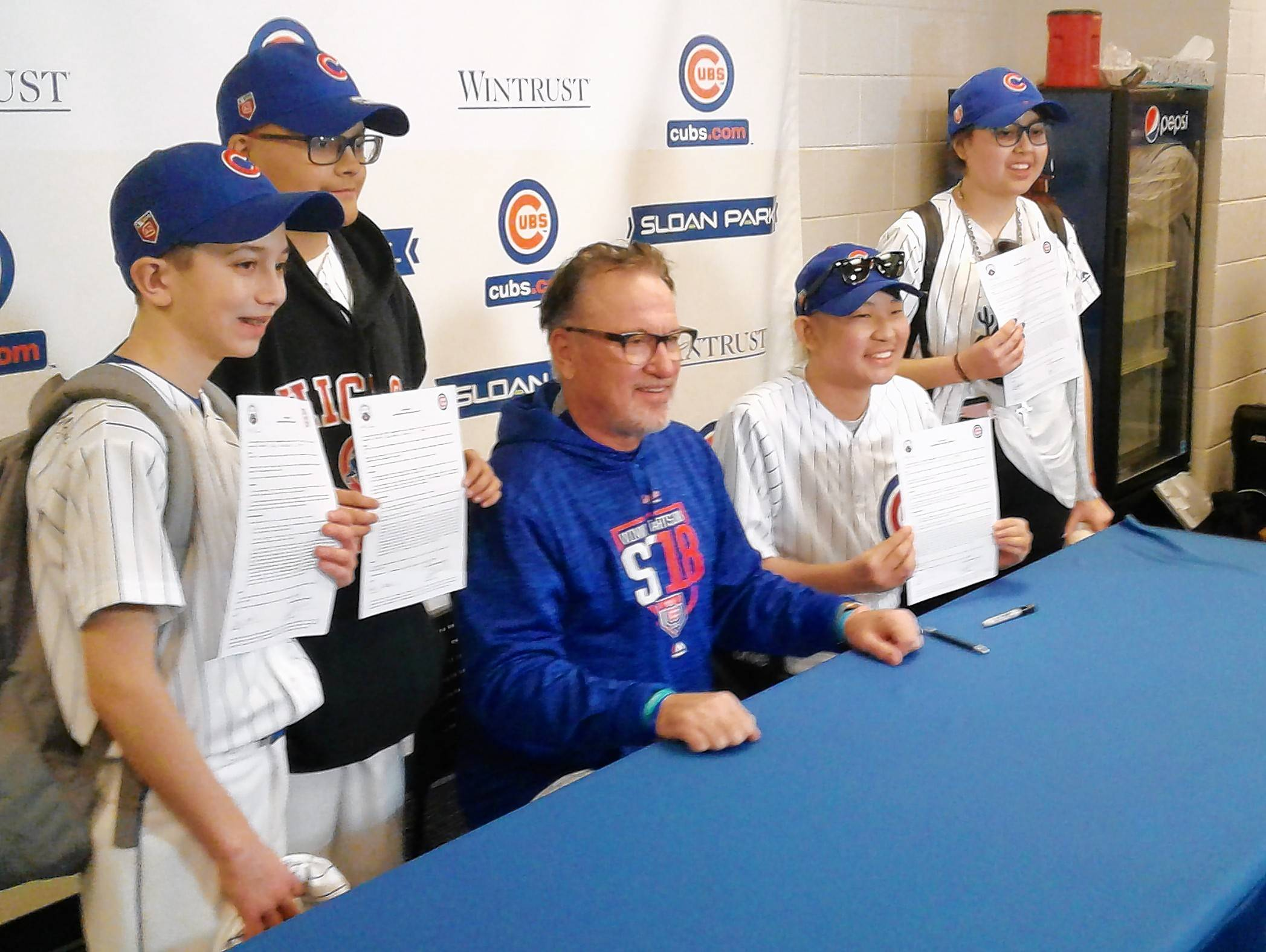 BRUCE MILES/bmiles@dailyherald.com Joe Maddon signs four Advocate Children's Hospital patients to one-day contracts. Left to right: Kyle Munch of Montgomery, Jonathan Olmos of Des Plaines, Zachary Lum of Sleepy Hollow and Izabella Marin of Chicago.