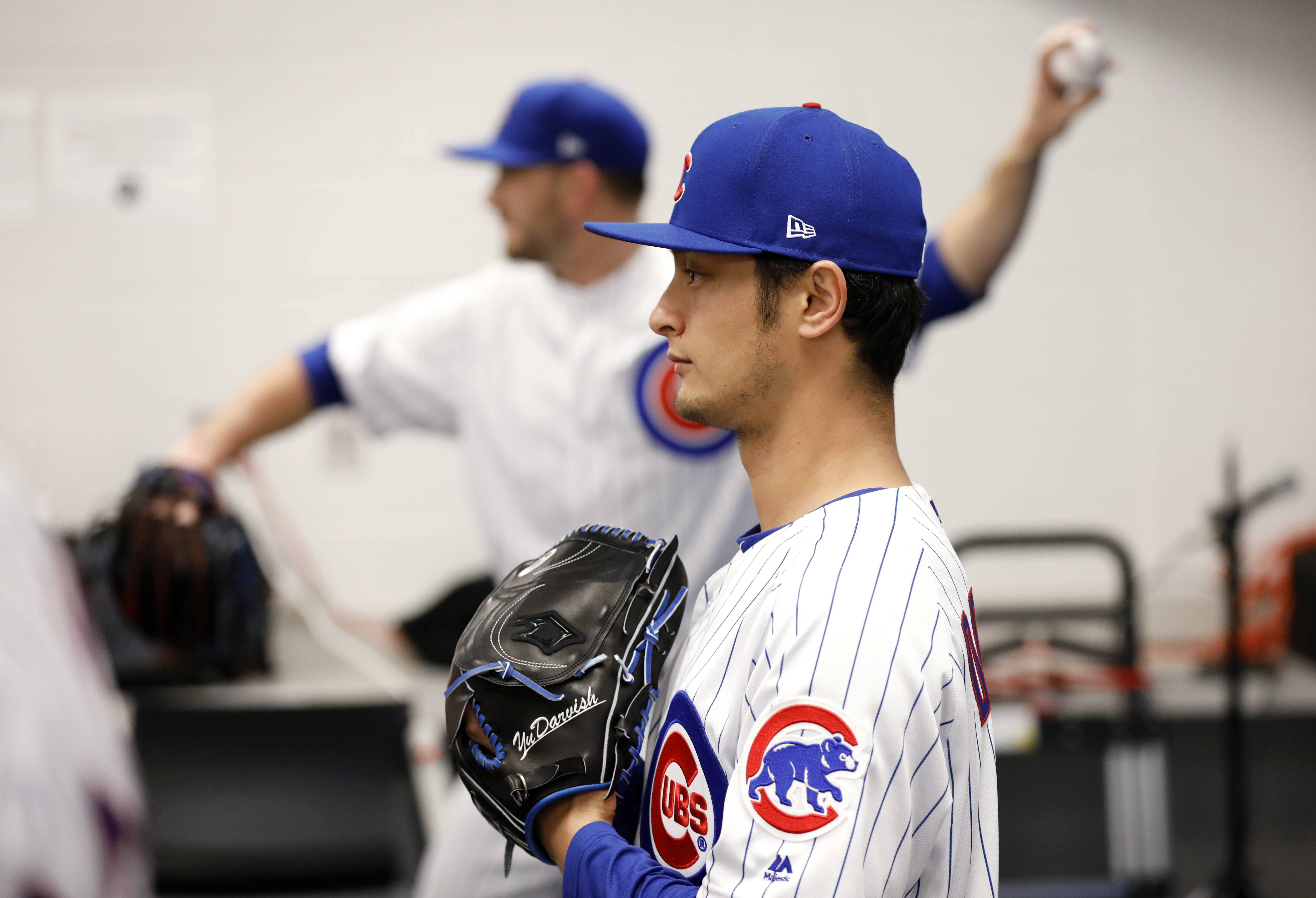 It was picture day at Chicago Cubs camp on Tuesday, and pitcher Yu Darvish, posing for the camera here, also painted quite a picture when he threw a live batting practice session during spring training workouts in Mesa, Ariz.