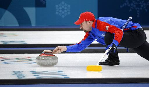 In this Saturday, Feb. 17, 2018 photo curler Joe Polo, of the United States, launches the stone during practice at the 2018 Winter Olympics in Gangneung, South Korea. Joe and Kristin Polo, both curlers, named their daughter Ailsa, after the Scottish island where the granite that makes curling rocks is mined. (AP Photo/Aaron Favila)