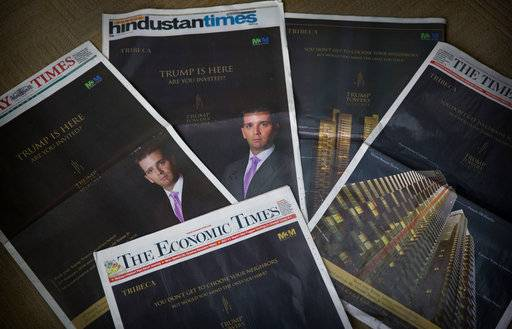 "The eldest son of US President Donald Trump, Donald Trump Jr's Trump Towers ads are seen in major newspapers in New Delhi, India, Tuesday, Feb. 20, 2018. ""Trump has arrived. Have you?"" shout the barrage of glossy front-page advertisements in almost every major Indian newspaper. The ads, which have run repeatedly in the past few days, herald the arrival not of the American president but of his eldest son, Donald Trump Jr., who is in New Delhi to sell luxury apartments and lavish attention on wealthy Indians who have already bought units in a Trump-branded development outside of the Indian capital. (AP Photo/Manish Swarup)"