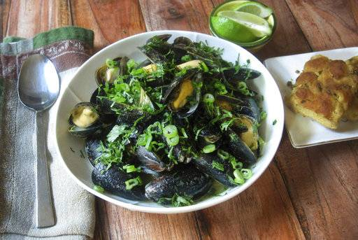 This February 2018 photo shows steamed mussels with Thai flavoring in New York. This dish is from a recipe by Sara Moulton. Here it is along with the photos shot last week by me at my home.
