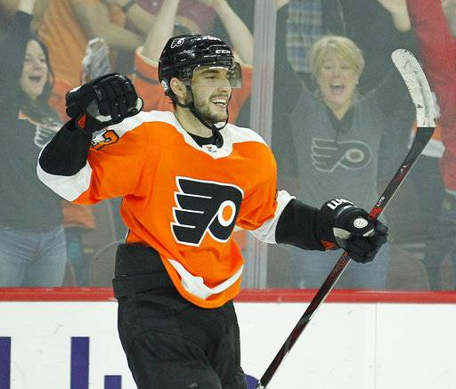 Philadelphia Flyers' Shayne Gostisbehere celebrates the game wining goal by Jakub Voracek during the overtime period of an NHL hockey game against the Montreal Canadiens' Tuesday, Feb. 20, 2018 in Philadelphia. Gostisbehere got the assist. Flyers won 3-2. (AP Photo/Tom Mihalek)
