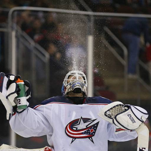 Columbus Blue Jackets goaltender Sergei Bobrovsky spits water before the second period against the New Jersey Devils in an NHL hockey game, Tuesday, Feb. 20, 2018, in Newark, N.J. The Blue Jackets won 2-1. (AP Photo/Adam Hunger)
