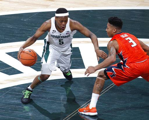 Michigan State's Cassius Winston, left, drives against Illinois' Te'Jon Lucas (3) during the first half of an NCAA college basketball game Tuesday, Feb. 20, 2018, in East Lansing, Mich. (AP Photo/Al Goldis)