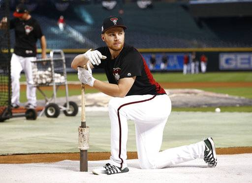 FILE - In this Wednesday, Oct. 4, 2017 file photo, Arizona Diamondbacks second baseman Brandon Drury waits to hit prior to the National League wild-card playoff baseball game against the Colorado Rockies in Phoenix. The Arizona Diamondbacks have sent infielder Brandon Drury to the New York Yankees and received outfielder Steven Souza Jr. from the Tampa Bay Rays in a three-team trade that includes five players, Tuesday, Feb. 20, 2018. (AP Photo/Ross D. Franklin)