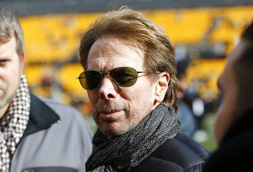 FILE - In this Sunday, Jan. 14, 2018 file photo, movie producer Jerry Bruckheimer stands on the sidelines before an NFL divisional football AFC playoff game between the Pittsburgh Steelers and the Jacksonville Jaguars in Pittsburgh. Fans longing for a professional hockey team in Seattle will soon be able to put down some money for season tickets. Billionaire David Bonderman and filmmaker Jerry Bruckheimer are leading the effort to bring a team to Seattle. The group submitted its expansion application with the National Hockey League last week. (AP Photo/Keith Srakocic, File)
