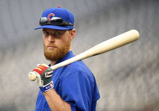 FILE - In this Oct. 5, 2017, file photo, Chicago Cubs' Ben Zobrist looks on during practice at Nationals Park, in Washington. At 36 years old, Zobrist is out to show he still has something left for the Cubs. The super utility man struggled in a big way last season after playing on back-to-back World Series winners _ with Kansas City in 2015 and the Cubs in 2016. (AP Photo/Nick Wass, File)
