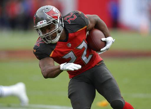 FILE - In this Nov. 12, 2017, file photo, Tampa Bay Buccaneers running back Doug Martin (22) runs during the second half of an NFL football game against the New York Jets, in Tampa, Fla. Two-time Pro Bowl running back Doug Martin has been released by the Tampa Bay Buccaneers, Tuesday, Feb. 20, 2018, who may look for a replacement in free agency.(AP Photo/Jason Behnken, File)