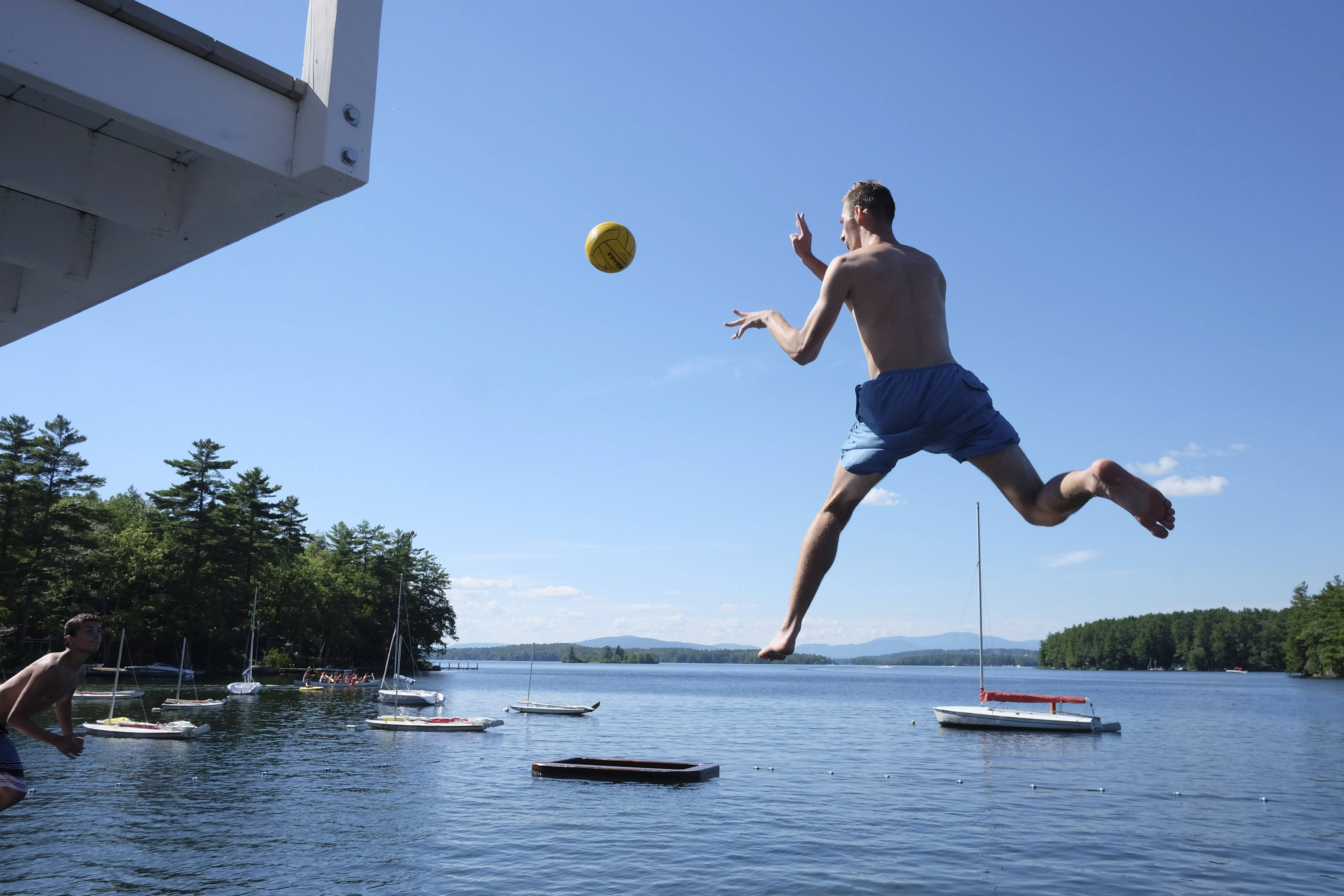 A camper takes a leap off of the 11-foot diving tower at Main Dock of Camp Belknap.