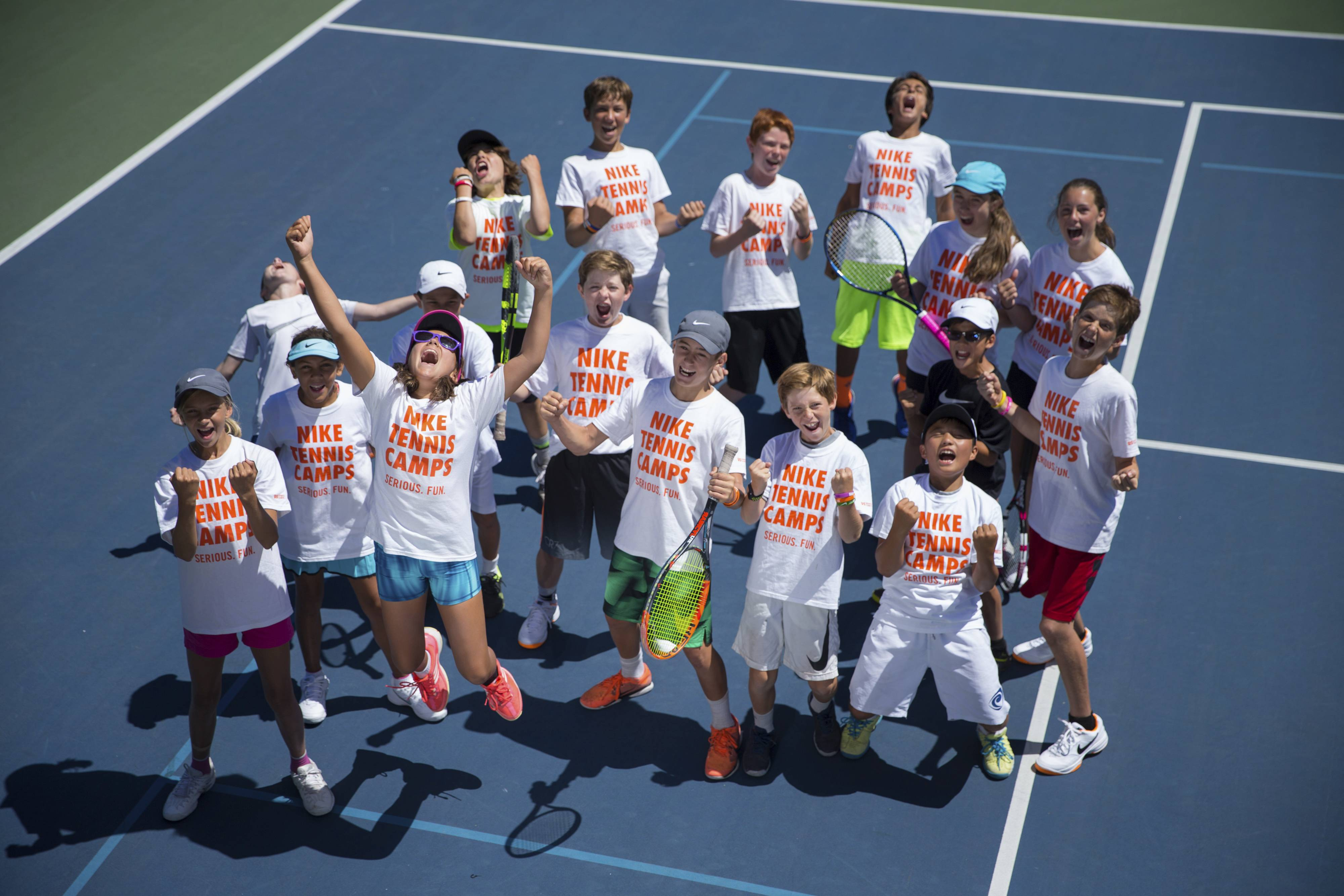 Kids have fun at the Stanford University Nike Tennis Camp in Stanford, California.
